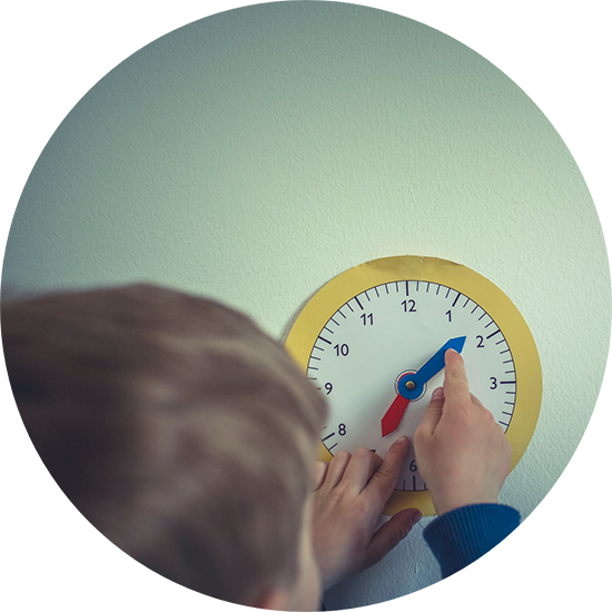 A boy measuring time